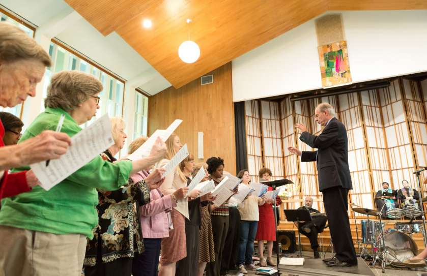 Dr. Henry Sgrecci directing the Adult Choir during a Sunday morning worship service