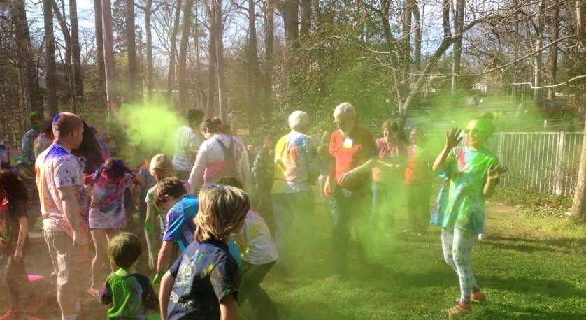 kids throwing colored sand during the Holi celebration at Cedar Lane in Spring 2017