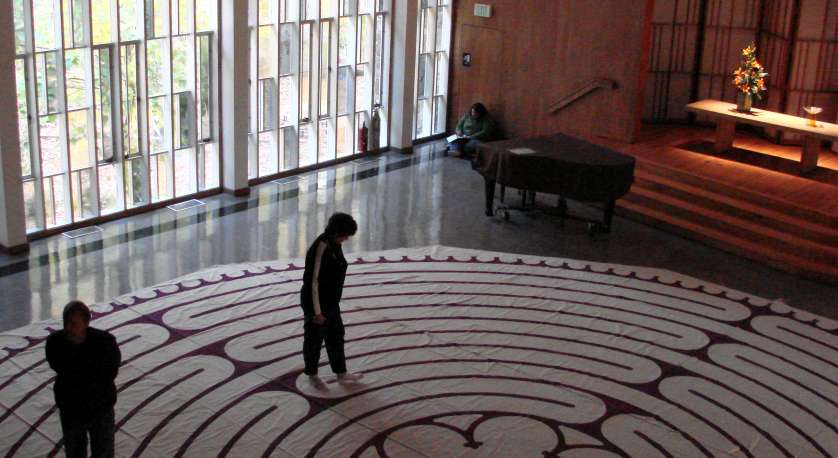 photo of two Cedar Laners walking on a labyrinth pattern in the Sanctuary at Cedar Lane