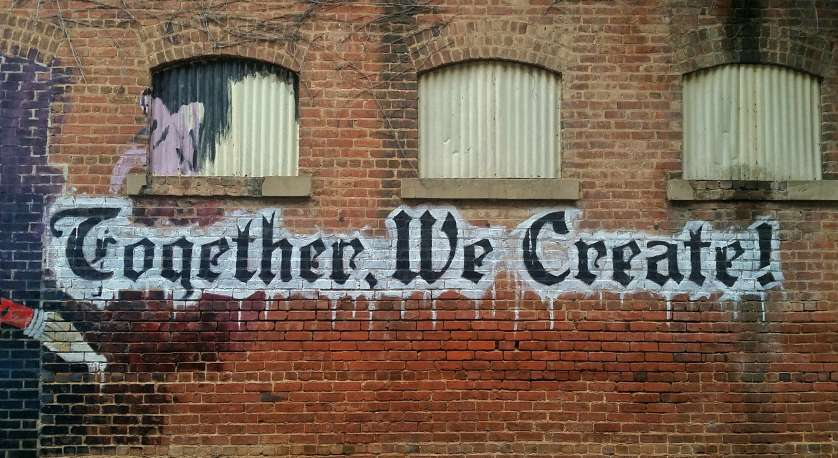 "street art that says ""Together, We Create!"""