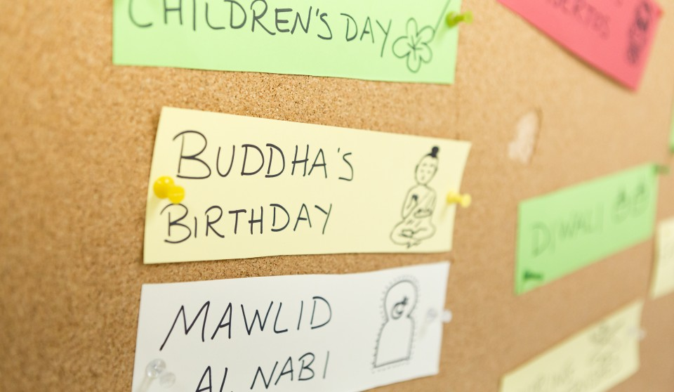 bulletin board full of names of different religious celebrations around the globe