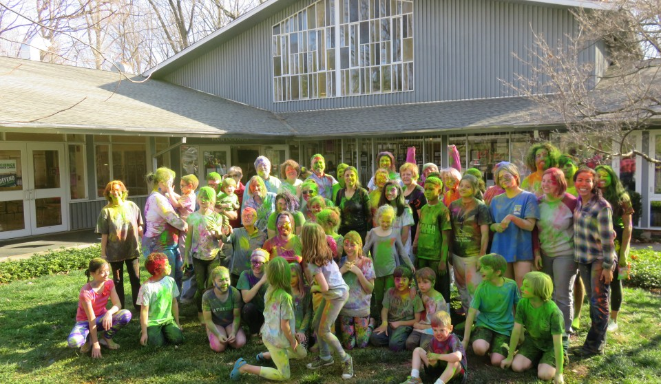 Holi Celebration outside of Cedar Lane main building in Spring 2017