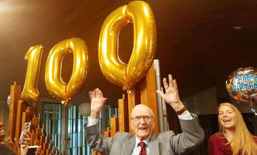 Fred Peters at his 100th Birthday celebration in the choir loft with his fellow choir members