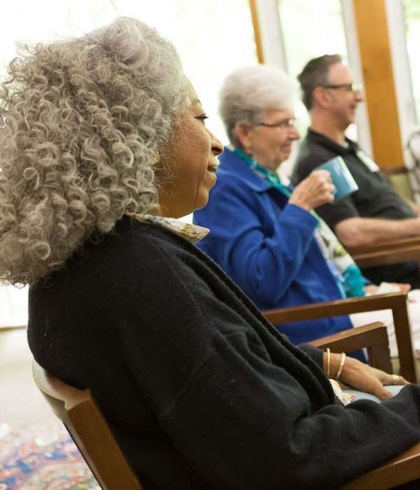 diverse group of people talking during a Soul Matters Small Group Ministry meeting