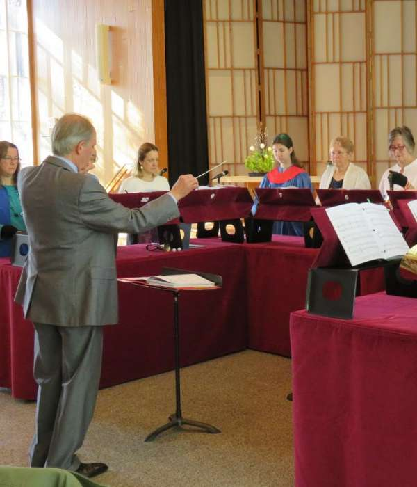 bell canto handbell choir performing during Sunday worship with Dr. Henry Sgrecci conducting