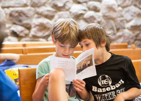two boys in the children's chapel during worship