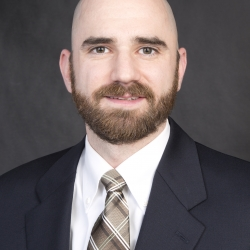 head shot of Jim Anderson in a suit and tie - Jim is the Board of Trustees President for Cedar Lane for 2017-18