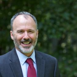 head shot of Norman Allen, Intern Minister, in Cedar Lane's courtyard